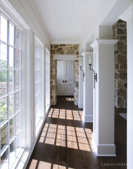 Christopher Architecture and Interiors Countryside Estate Light Filled Hallway Transition with Shadows from Windows